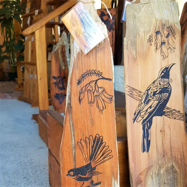 Fantail and Tui carvings